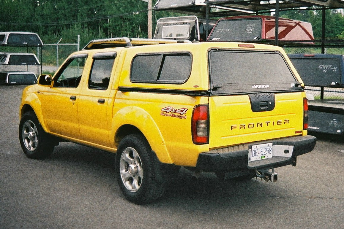 Nissan Frontier with Arrow Mark I canopy & Import Canopies | The Canopy Store